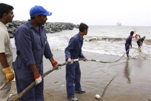 Alcatel-Lucent contractors lay the TEAMS fibre optic cable on the Fujairah shore-end in the UAE
